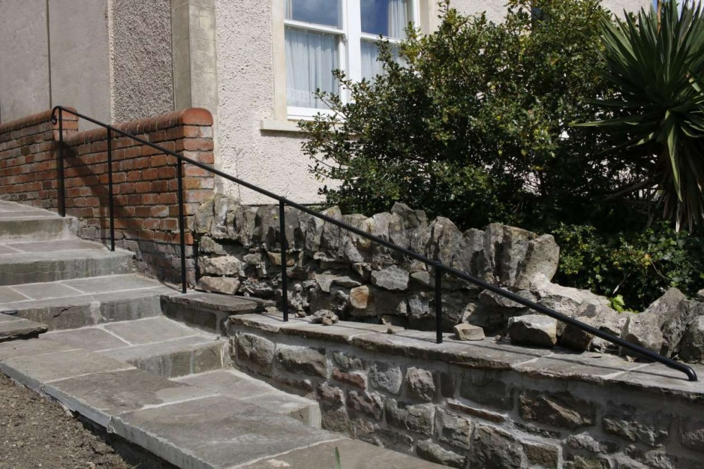 Hand forged railings up steps to house